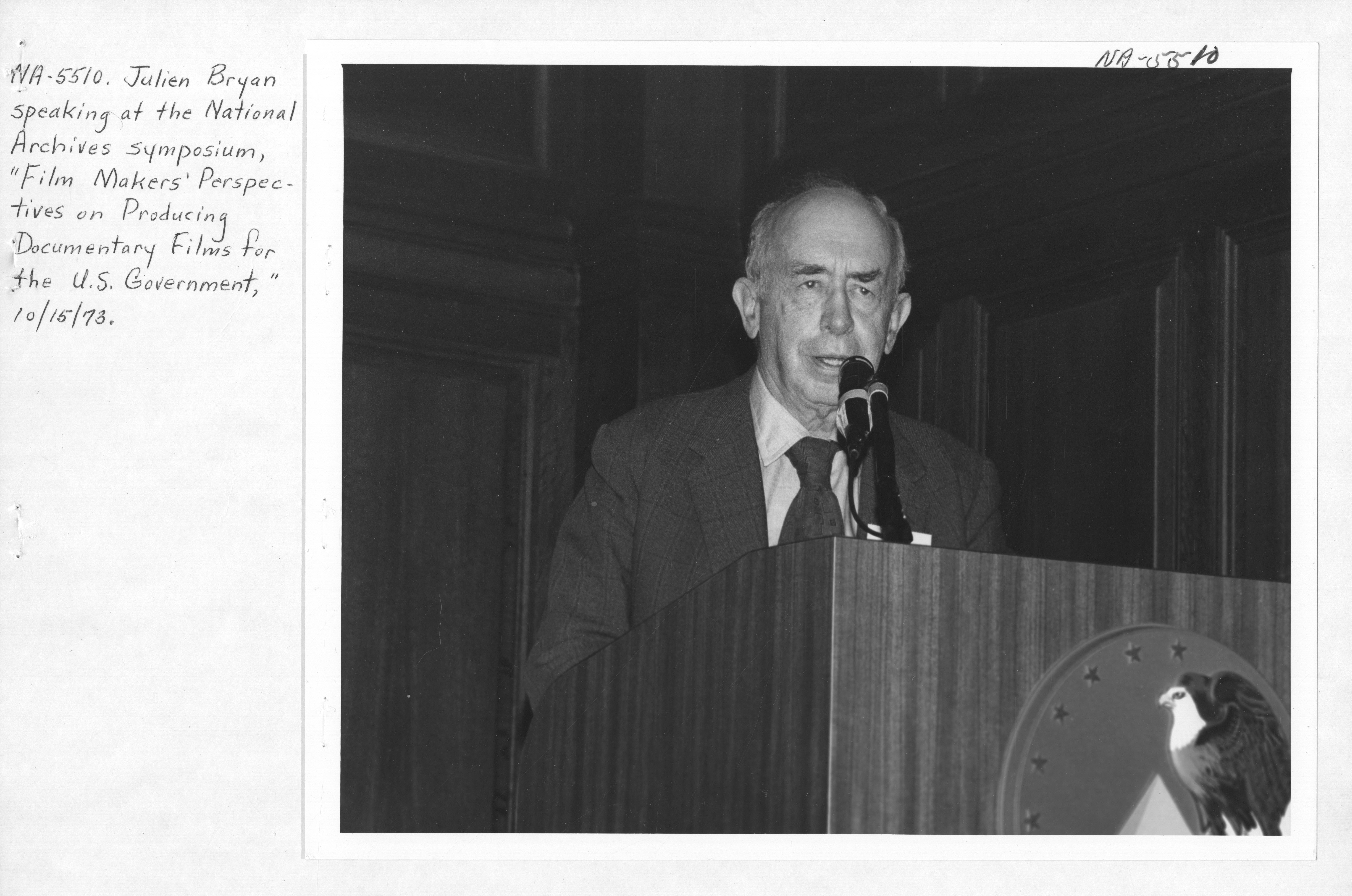 Photograph of Julien Bryan Speaking at the National Archives Symposium on