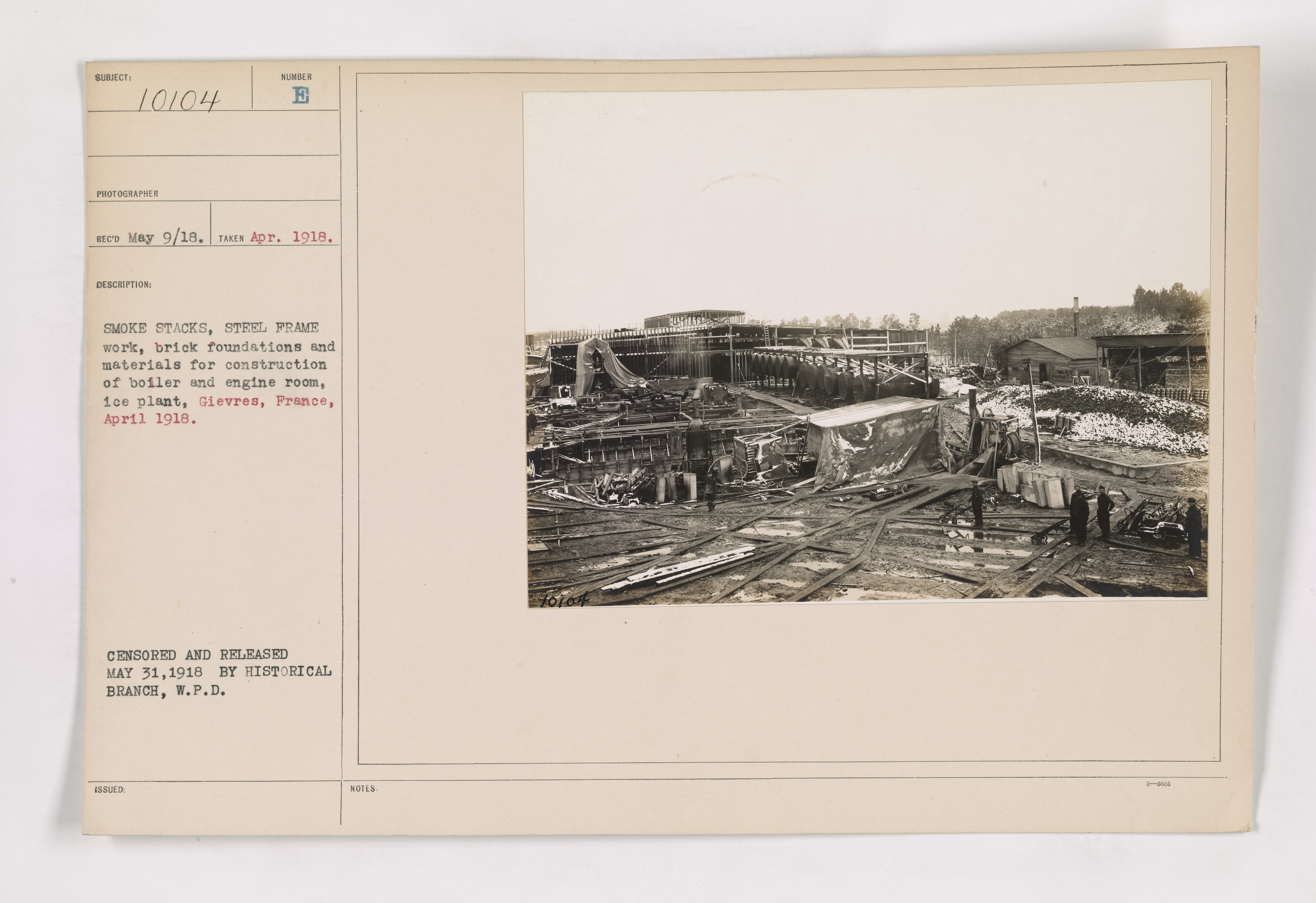 111-SC-10104 - Smoke stacks, steel frame work, brick foundations and materials for construction of boiler and engine room, ice plant. Gievres, France. April 1918