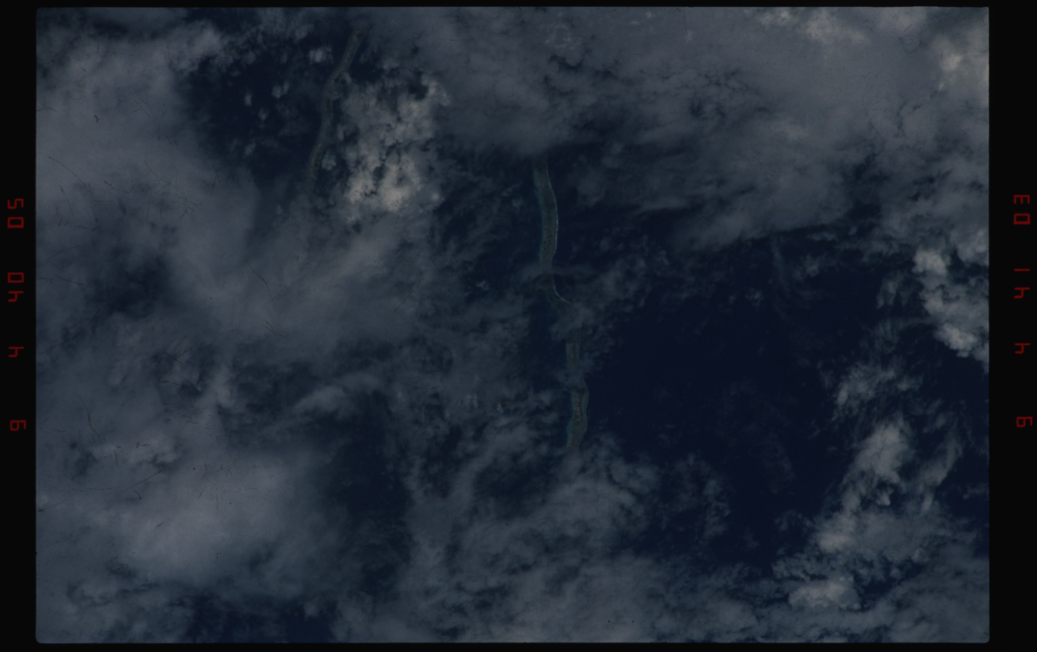 STS050-11-028 - STS-050 - Earth observation scene of an unidentified Tuamotu Archipelago atoll.