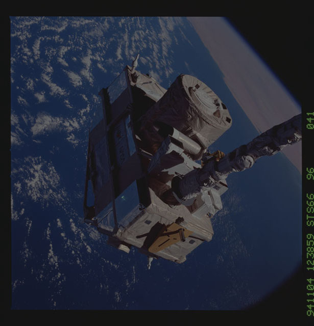 STS066-96-041 - STS-066 - CRISTA-SPAS - Atlantis' RMS deploys the CRISTA-SPAS during STS-66 mission