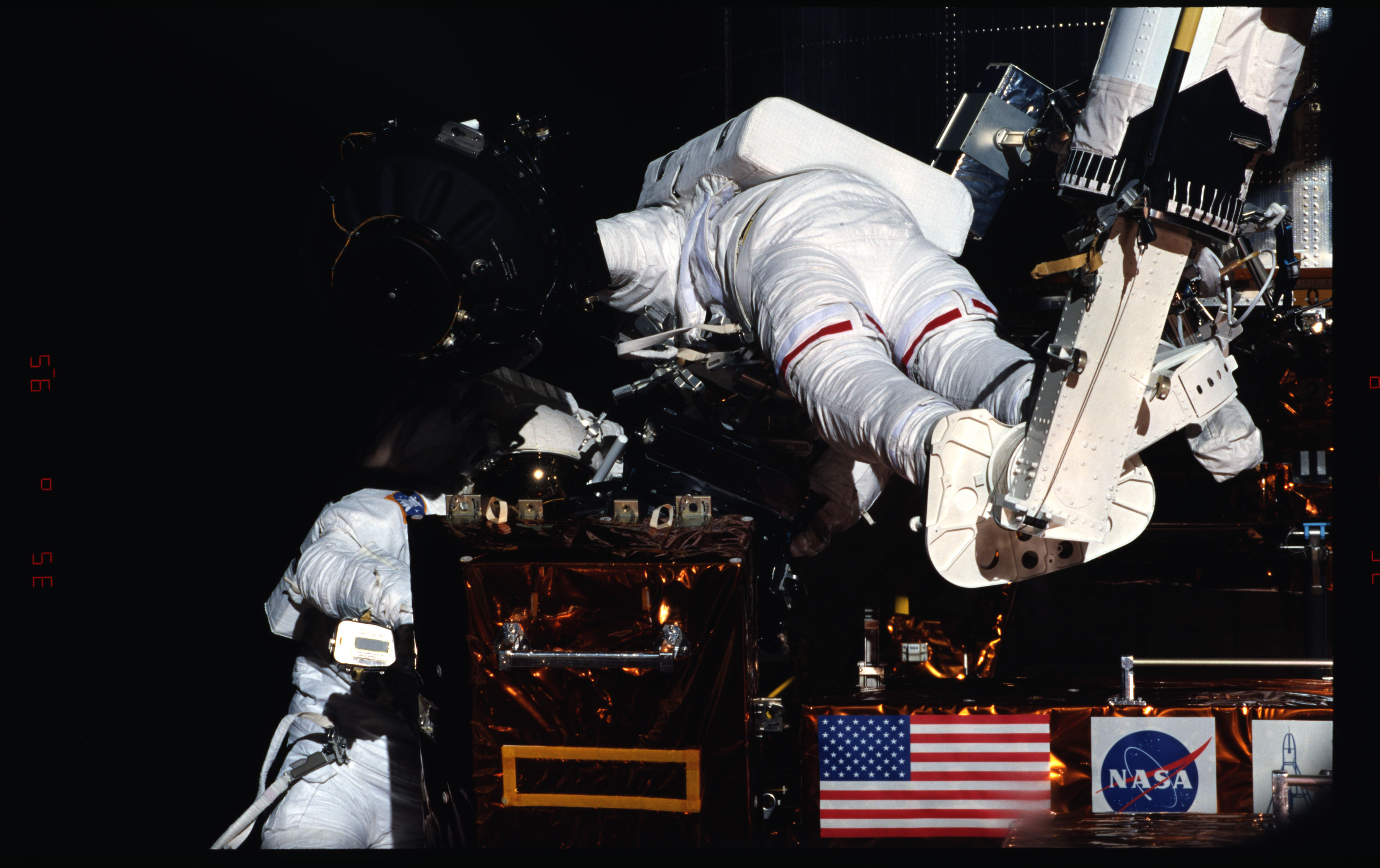 STS082-339-011 - STS-082 - EVA 3 activity on Flight Day 6 to service the Hubble Space Telescope