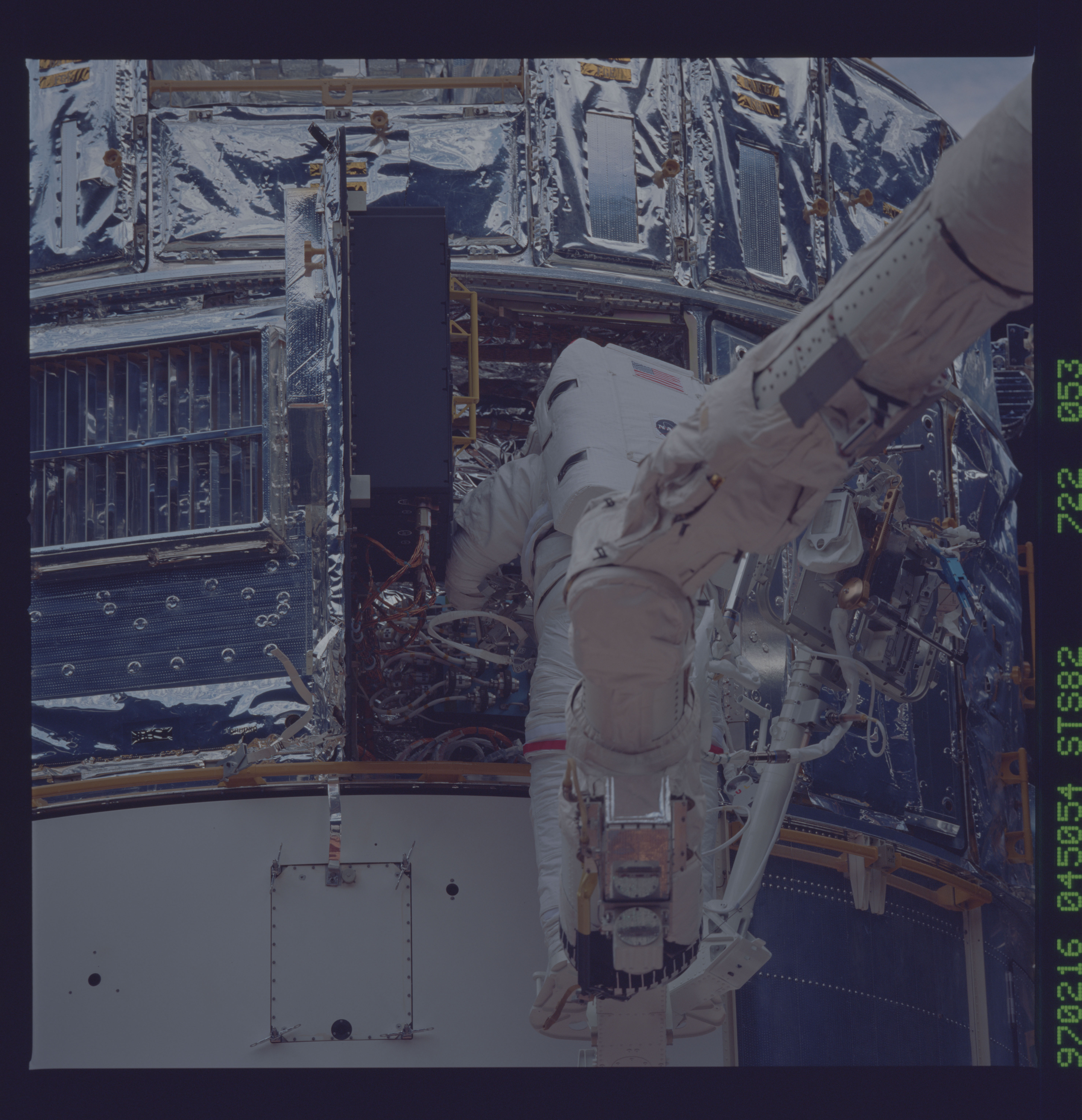 STS082-722-053 - STS-082 - EVA 3 on Flight Day 6 to service the Hubble Space Telescope