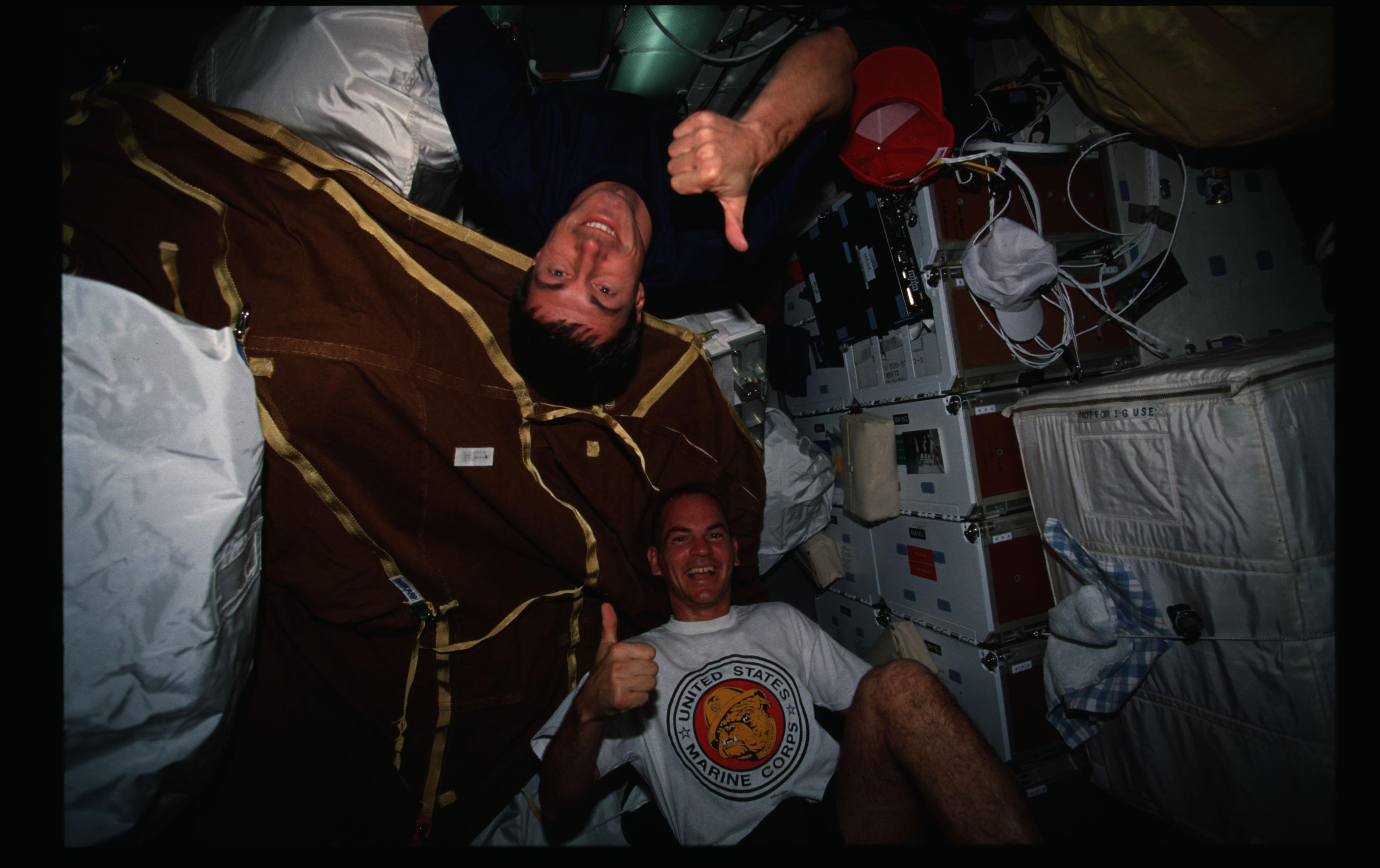 STS088-307-029 - STS-088 - Sturckow and Krikalev on middeck