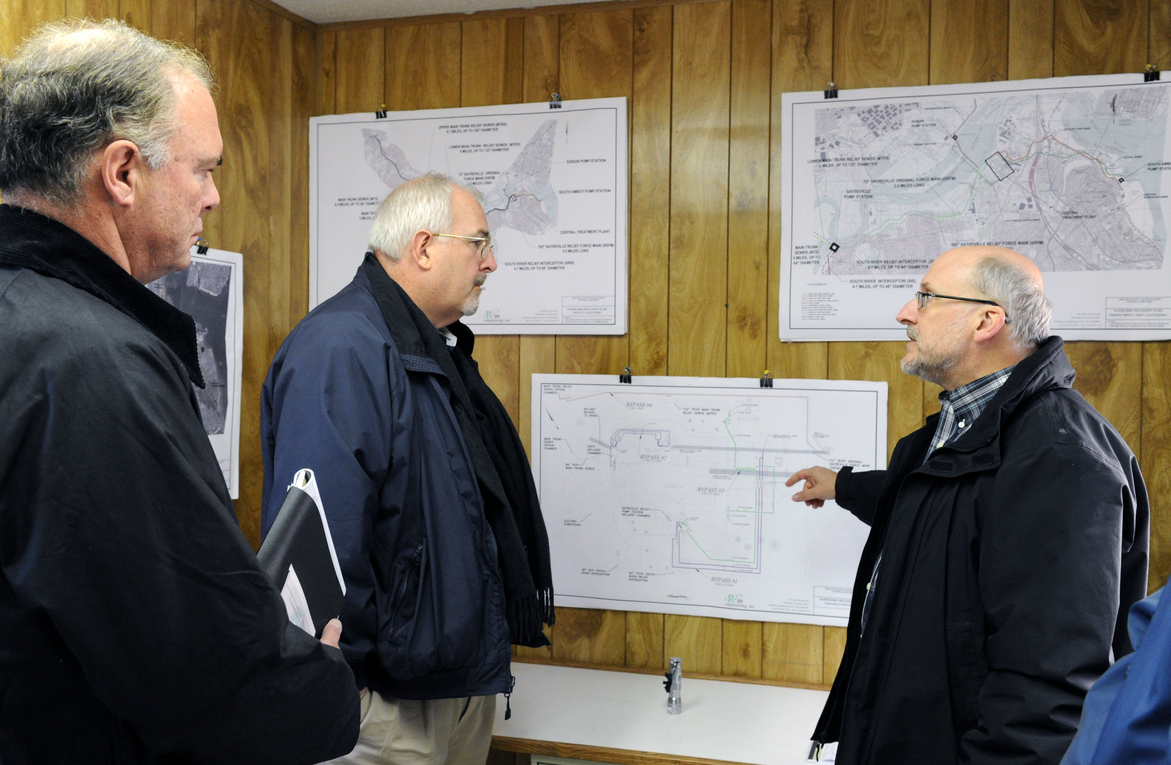 Sayerville, N.J., Nov. 28, 2012 -- FEMA Administrator Craig Fugate, center, and Commissioner of NJ Environmental Protection Bob Martin, get a briefing on the local Water Pumping Station that was impacted during Hurricane Sandy, by Water and Wastewater Engineer Michael Samuel. The station was underwater during the storm. Jocelyn Augustino/FEMA